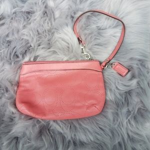 Coach pink zip top wristlet . Pink salmon color wi